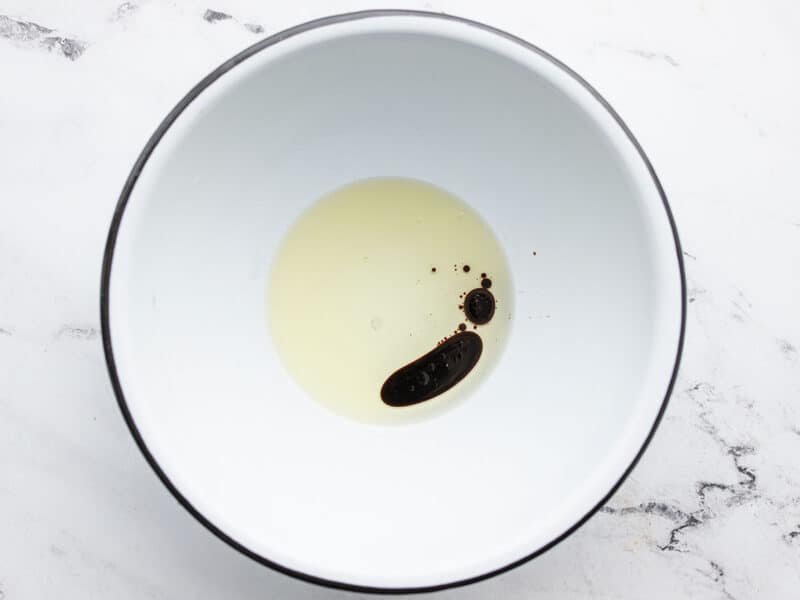 cooking oil and soy sauce in a large bowl